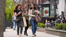 Pedestrians on Boston's Newbury Street on May 2,
