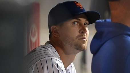 Mets starting pitcher Jacob deGrom looks on in