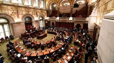 New York state Senate members meet in the