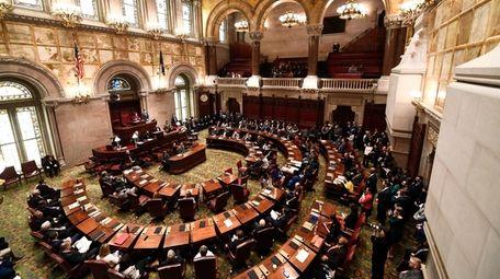 New York state Senate members meet in the