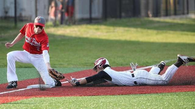 Troy Emmanuel of Plainedge beats the throw to