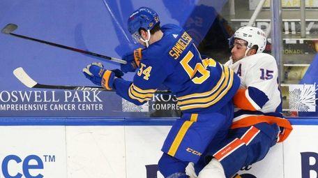 Buffalo Sabres defenseman Mattias Samuelsson (54) checks Islanders