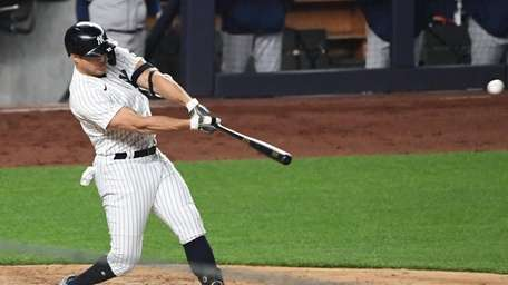 Yankees designated hitter Giancarlo Stanton doubles against the