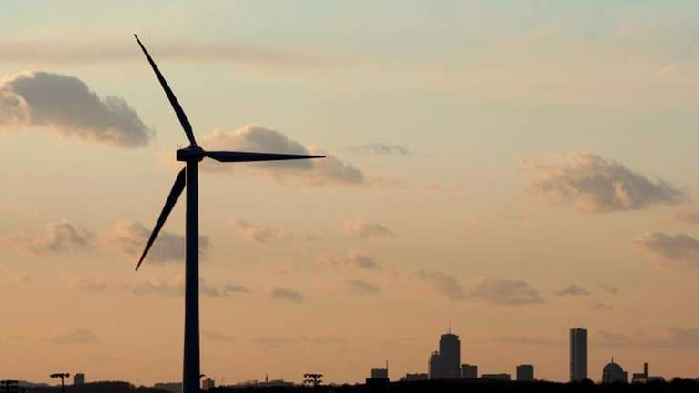 A wind turbine stands, generating power next to