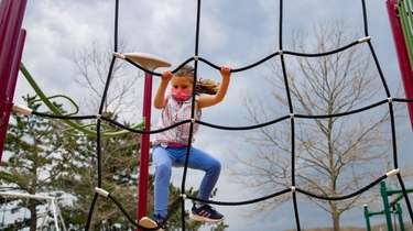 Anna Jezykowski, 6, of Northport plays in the