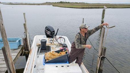 Bayman John Buczak unties his boat docked on