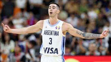 Argentina's Luca Vildoza gestures against Serbia during a