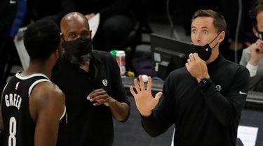 Nets head coach Steve Nash talks with Jeff