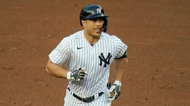 Yankees' Giancarlo Stanton runs the bases after hitting