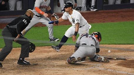 Yankees second baseman Rougned Odor scores behind Houston
