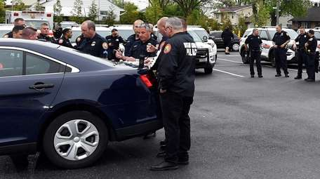 Hicksville fire department members and Nassau police gather