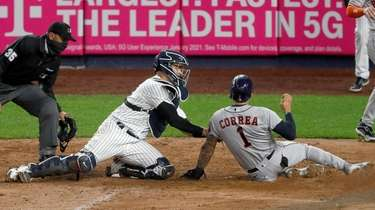 Gary Sanchez of the Yankees tags out Carlos