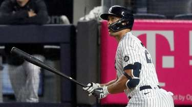 Giancarlo Stanton #27 of the Yankees follows through