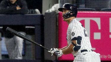 Giancarlo Stanton #27 of the Yankees follows through