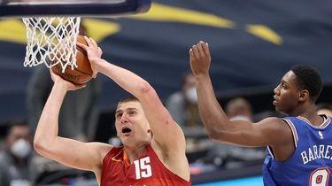 Nikola Jokic #15 of the Denver Nuggets dunks