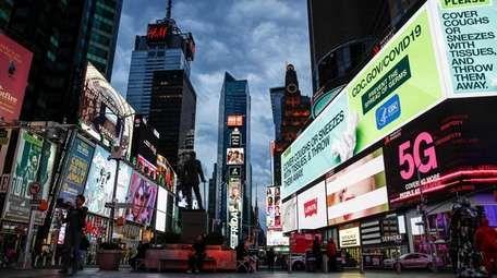 Screens lit up a sparsely populated Times Square