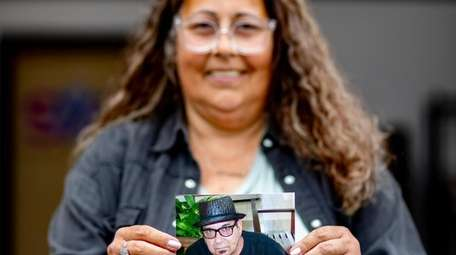 Rachel Gentile holds a picture of her late