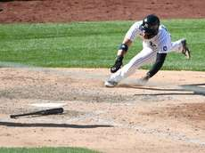 Yankees shortstop Gleyber Torres dives to home plate