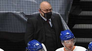 Islanders head coach Barry Trotz looks on in