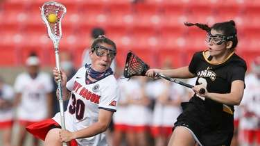 Stony Brook's midfielder Ally Kennedy (30) takes the