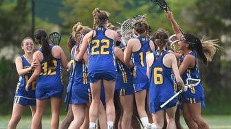 West Islip girls lacrosse teammates celebrate their 13-12