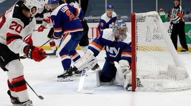 Semyon Varlamov #40 of the Islanders surrenders a