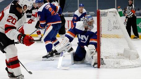 Semyon Varlamov #40 of the Islanders surrenders a