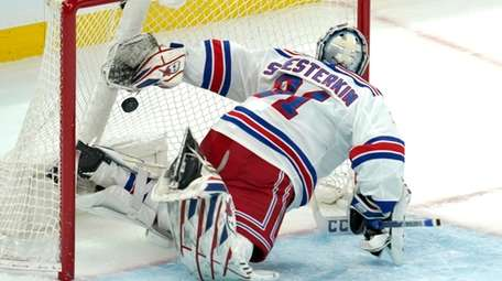 Rangers goaltender Igor Shesterkin watches the puck go