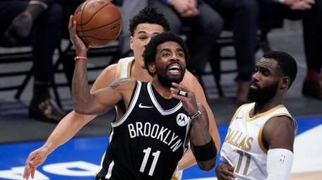 Brooklyn Nets guard Kyrie Irving (11) drives to