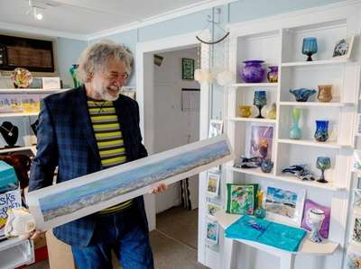 "Artist Bob Kuhne his work ""Foamy Sea,"" which"