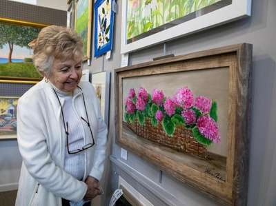 """Artist Helene Canberg with her """"Pink Geraniums."""""""
