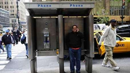 A man makes a phone call with his