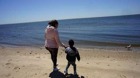 Karen Espinosa, of Central Islip, with her son,