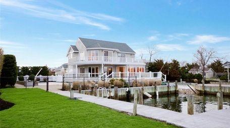 Priced at $1,350,000, this five-bedroom, 4½-bathroom Postmodern home