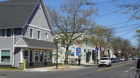 Businesses and houses on Main Street in Islip