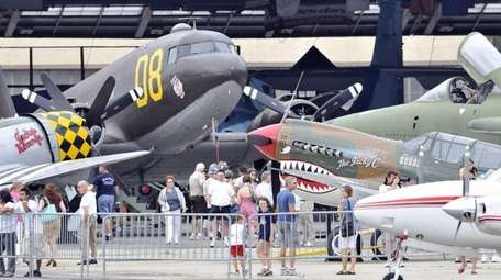 Aviation enthuiasts toured the old warbirds at the