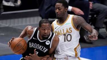 Brooklyn Nets forward Kevin Durant works to the