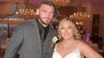 Joe Smith Jr. and his bride, Kelly, at