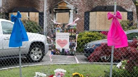 Friends and neighbors tied ribbons and laid flowers