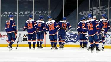The Islanders skate off the ice after a