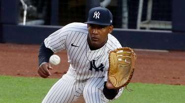Miguel Andujar #41 of the Yankees gets an