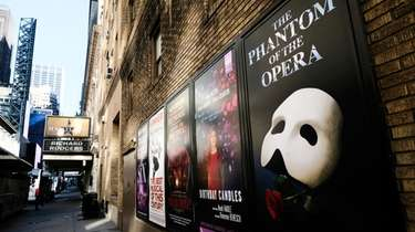 Broadway posters hang outside the Richard Rodgers Theatre