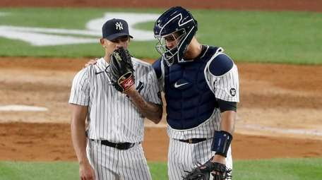 Gary Sanchez #24 of the Yankees talks to