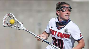 Stony Brook's midfielder Ally Kennedy (30) looks to