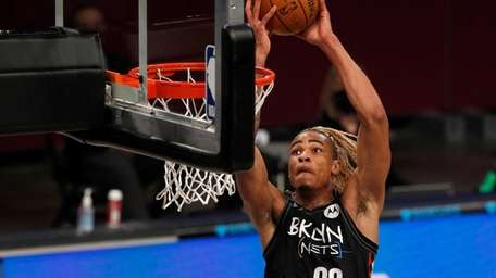 Nic Claxton #33 of the Nets goes to