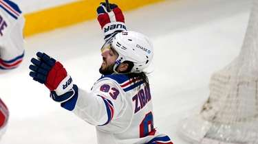 Rangers center Mika Zibanejad (93) raises his arms