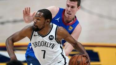 Nets forward Kevin Durant drives against Denver Nuggets