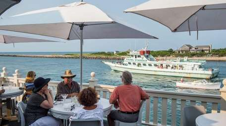 Diners overlook the Montauk Inlet at Gosman's Topside