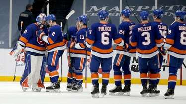 Islanders goalie Ilya Sorokin celebrates with teammates after