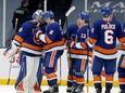 Islanders goalie Ilya Sorokin celebrates with teammates after